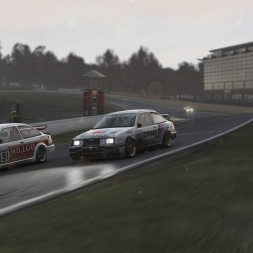 Race winning overtake on last lap, around the outside, under the rain, after 40 seconds side by side!